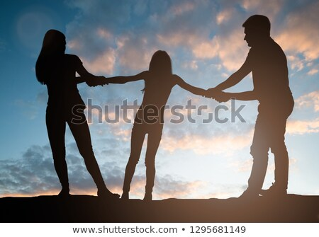 Parents Pulling Their Child Against Each Other Stock photo © AndreyPopov