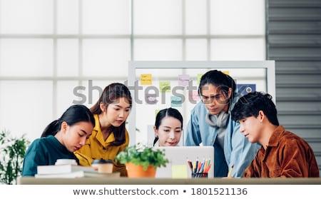 stressed designer with user interface on laptop Stock photo © dolgachov