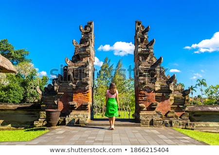 Foto stock: Young Woman Tourist In Traditional Balinese Hindu Temple Taman Ayun In Mengwi Bali Indonesia