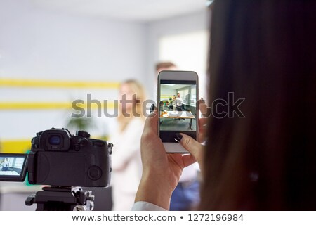 Woman taking photo of business partners actors stock photo © frimufilms