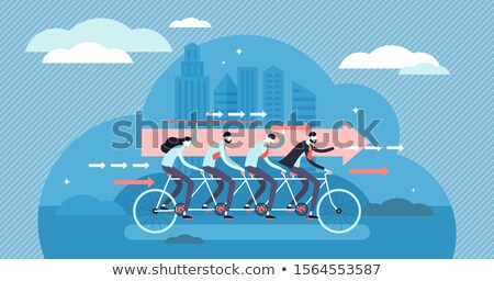 Team of motivated business people driving a project forward Stock photo © Kzenon