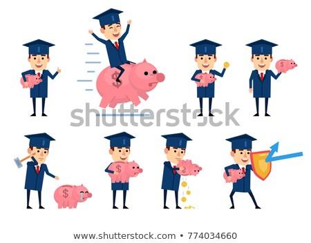 Homem piggy bank graduação boné mão Foto stock © AndreyPopov