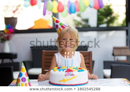 Little boy and happy birthday balloon stock photo © colematt