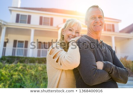 Attractive Middle-aged Couple In Front Of Their House Stockfoto © feverpitch