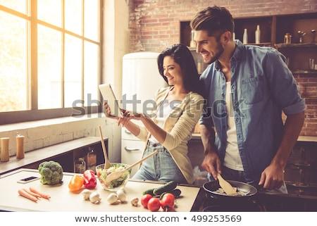 Donna cucina tablet lettura ricetta Foto d'archivio © boggy