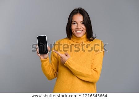 удивительный возбужденный женщину позируют изолированный серый Сток-фото © deandrobot