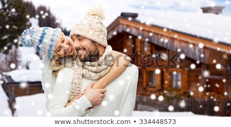 happy couple in winter clothes hugging over snow Stock photo © dolgachov