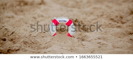Lifebuoy Dig In The Sand At Beach Stock photo © AndreyPopov