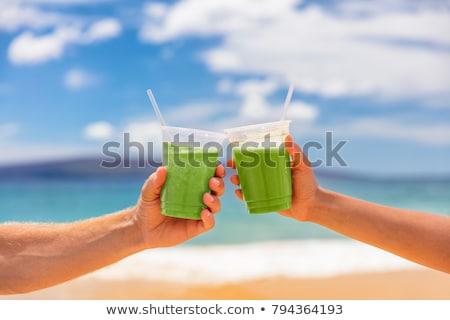 Pár pirít dzsúz szemüveg tengerpart párok Stock fotó © AndreyPopov