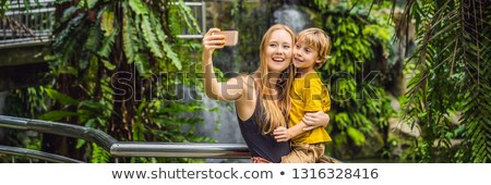 Mom and son take a selfie on the background of a waterfall BANNER, LONG FORMAT Stock photo © galitskaya