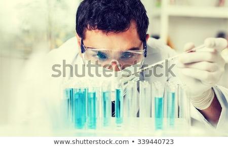 Férfi vegyész dolgozik labor férfi üveg Stock fotó © Elnur