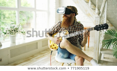 Happy guitarist with headset Stock photo © nyul