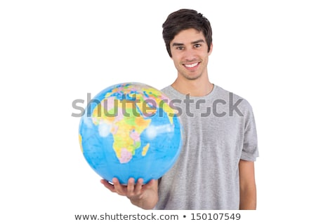 Handsome man holding globe smiling Stock photo © nyul