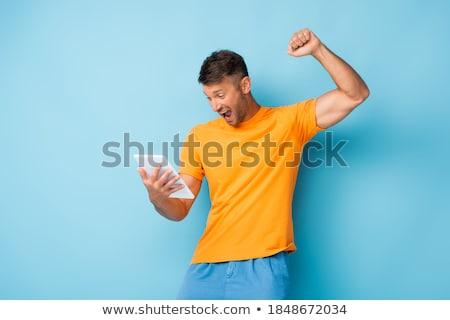 feliz · hombre · joven · éxito · sonrisa - foto stock © nyul