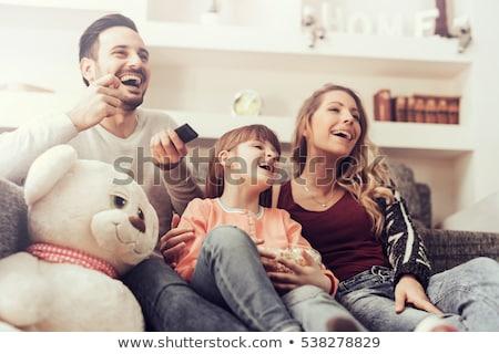 幸せ カップル ポップコーン を見て テレビ ホーム ストックフォト © dolgachov
