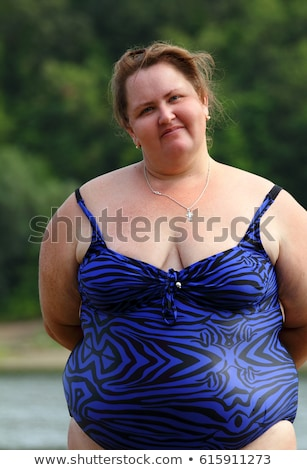 plump woman standing near river Stock photo © Mikko