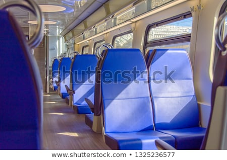 Interior of a Dutch train with blue seats Stock photo © Hofmeester