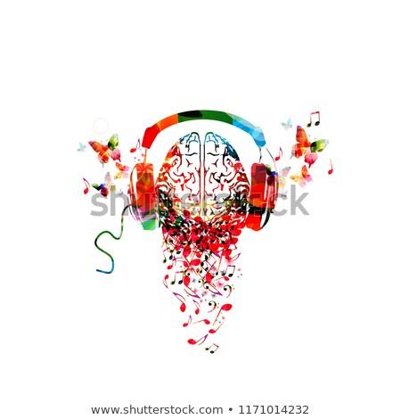 słuchać · muzyki · widok · z · tyłu · młody · człowiek · słuchania · słuchawki - zdjęcia stock © lightsource