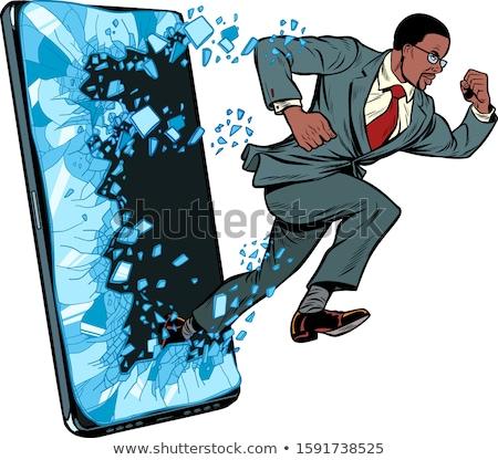 businessman punches the screen Phone gadget smartphone. Online Internet application service program Stock photo © studiostoks