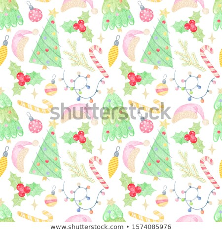 Festive Christmas or New Year garland. Christmas Tree Branches with candy cane and light garland. Ho Stock photo © olehsvetiukha
