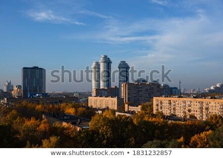 Cityscape maisons ensoleillée brumeux ciel ville Photo stock © artjazz