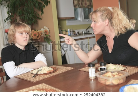 A teen dont want to eat his diner in the kitchen table. Stock photo © Lopolo