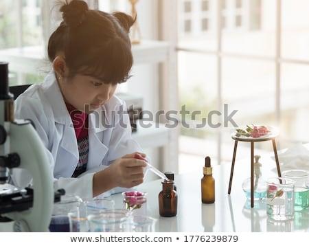 Iskolás lány tudomány iskola klub kísérlet gyerekek Stock fotó © robuart