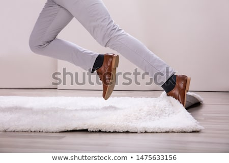 Man Stumble In A Carpet Stock photo © AndreyPopov