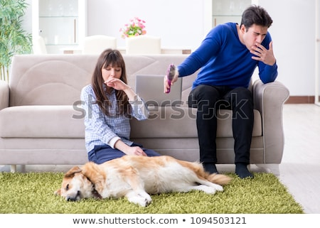 The man having allergy from dog fur Stock photo © Elnur