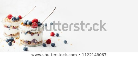 Stock photo: raspberry and blueberry on a spoon with yogurt
