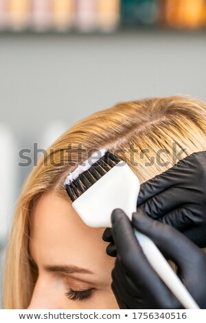 applying cosmetic with applicator stock photo © imarin