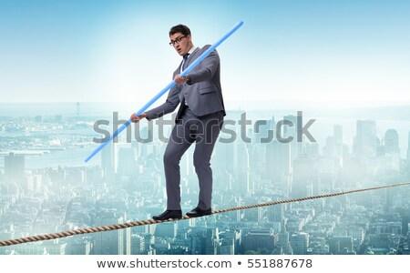 бизнесменов туго натянутый канат человека группа костюм Финансы Сток-фото © carbouval