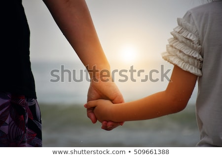 Mother holding daughter at the beach Stock photo © photography33