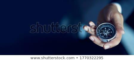 prata · bússola · isolado · branco · mão · fundo - foto stock © posterize