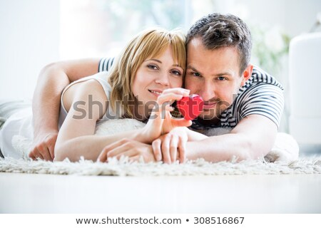 a couple lying on a carpet stock photo © photography33