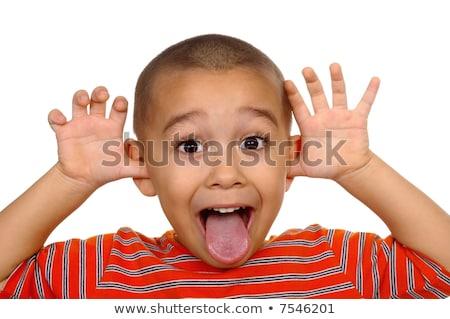 horizontal portrait of a young boys silly face stock photo © dacasdo