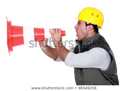 Builder shouting through traffic cone Stock photo © photography33
