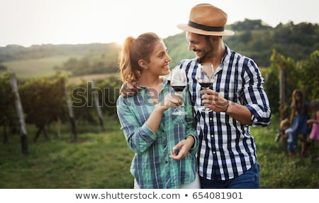 Сток-фото: Couple Drinking Wine By Vineyard