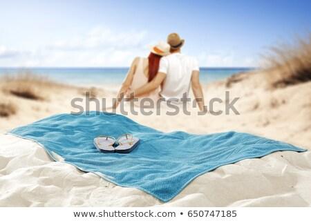 человека пляжное полотенце пляж пейзаж волос мобильных Сток-фото © photography33