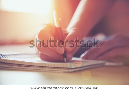 Woman writing with pen Stock photo © photography33
