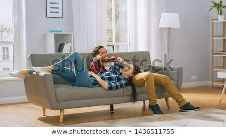 Couple lying on the couch Stock photo © photography33