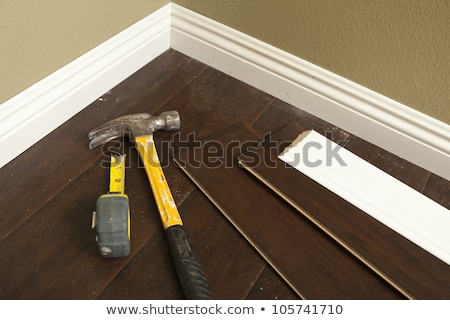 Hammer, Laminate Flooring and New Baseboard Molding Stock photo © feverpitch