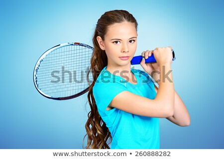 Female teenager holding tennis racket Stock photo © photography33