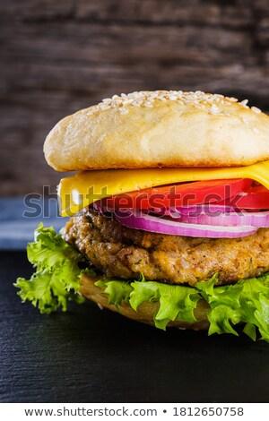 Saboroso cheeseburger fatia queijo isolado gordura Foto stock © ozaiachin