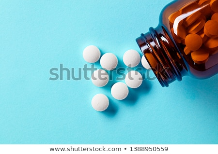 Spilled tablets and medicine bottle. Stock photo © Tatik22