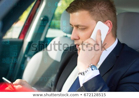 businessman making phone call in his car stock photo © photography33