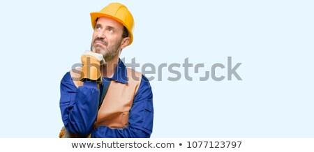 Intrigado construção azul indústria trabalhador Foto stock © photography33