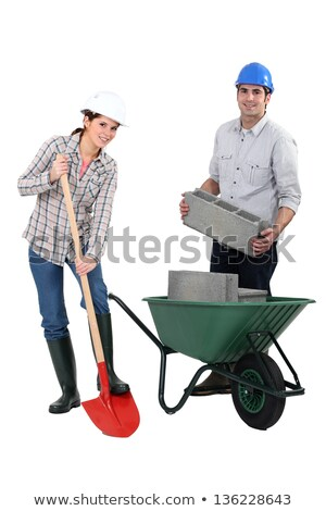 female bricklayer with shovel and male counterpart Stock photo © photography33