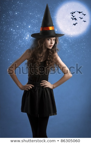 portrait of beautiful witch wearing a huge hat Stock photo © carlodapino