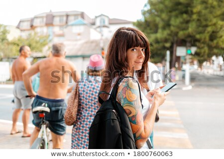 brunette with tattoo on her back stock photo © acidgrey